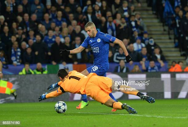 Islam Slimani in action with Sergio Rico of Sevilla during the UEFA Champions League Round of 16 match between Leicester City and Sevilla FC at...