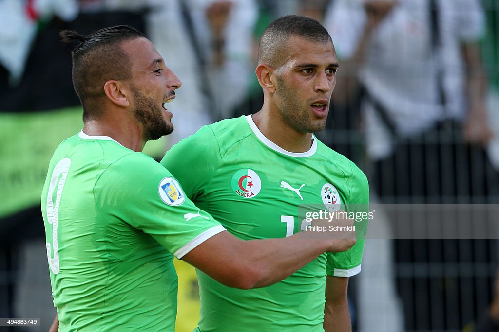 <a gi-track='captionPersonalityLinkClicked' href=/galleries/search?phrase=Islam+Slimani&family=editorial&specificpeople=9704639 ng-click='$event.stopPropagation()'>Islam Slimani</a> (R) of Algeria celebrates his scored goal with teammate <a gi-track='captionPersonalityLinkClicked' href=/galleries/search?phrase=Nabil+Ghilas&family=editorial&specificpeople=10062847 ng-click='$event.stopPropagation()'>Nabil Ghilas</a> (L) during the international friendly match between Algeria and Armenia at Estadio Tourbillon on May 31, 2014 in Sion, Switzerland.