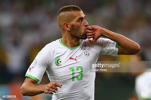 Islam Slimani of Algeria celebrates scoring his team's first goal during the 2014 FIFA World Cup Brazil Group H match between Algeria and Russia at...