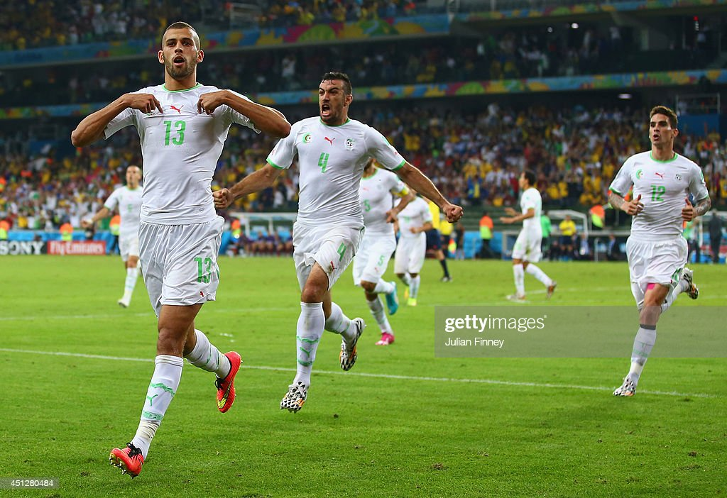 <a gi-track='captionPersonalityLinkClicked' href=/galleries/search?phrase=Islam+Slimani&family=editorial&specificpeople=9704639 ng-click='$event.stopPropagation()'>Islam Slimani</a> of Algeria (L) celebrates scoring his team's first goal with teammates Essaid Belkalem (C) and <a gi-track='captionPersonalityLinkClicked' href=/galleries/search?phrase=Carl+Medjani&family=editorial&specificpeople=622553 ng-click='$event.stopPropagation()'>Carl Medjani</a> (R) during the 2014 FIFA World Cup Brazil Group H match between Algeria and Russia at Arena da Baixada on June 26, 2014 in Curitiba, Brazil.
