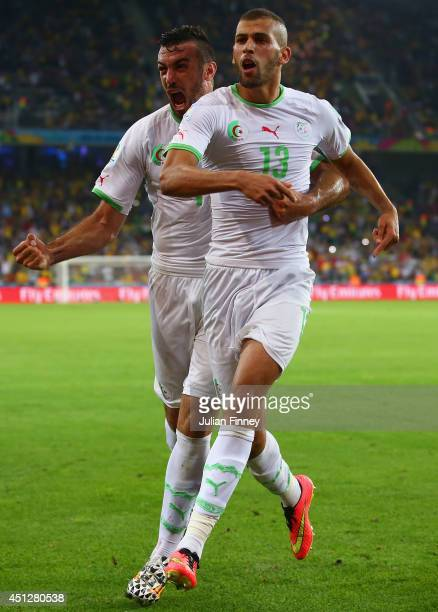 Islam Slimani of Algeria celebrates scoring his team's first goal with Essaid Belkalem during the 2014 FIFA World Cup Brazil Group H match between...