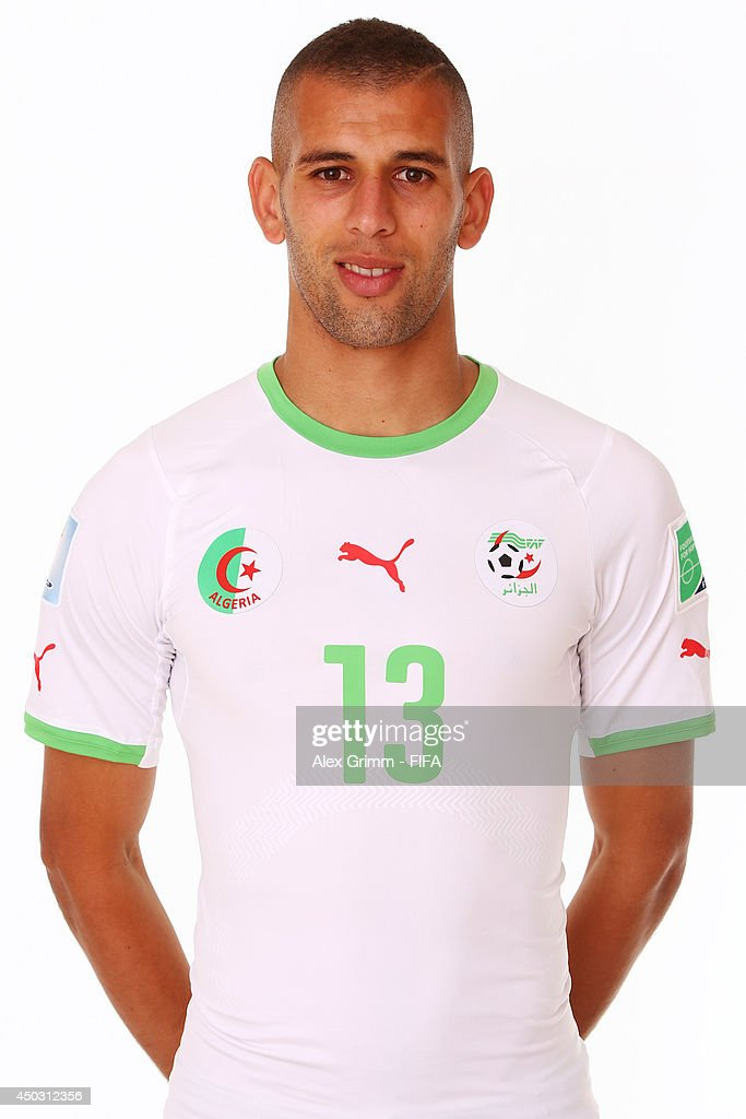 <a gi-track='captionPersonalityLinkClicked' href=/galleries/search?phrase=Islam+Slimani&family=editorial&specificpeople=9704639 ng-click='$event.stopPropagation()'>Islam Slimani</a> of Algeria poses during the official FIFA World Cup 2014 portrait session on June 8, 2014 in Sao Paulo, Brazil.