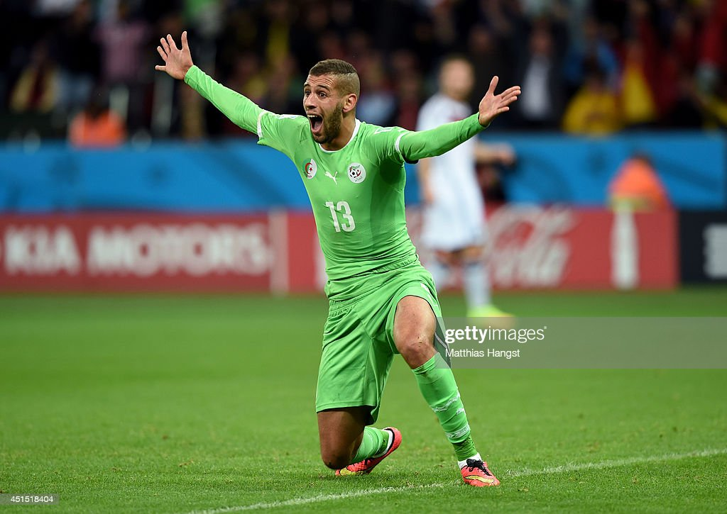 <a gi-track='captionPersonalityLinkClicked' href=/galleries/search?phrase=Islam+Slimani&family=editorial&specificpeople=9704639 ng-click='$event.stopPropagation()'>Islam Slimani</a> of Algeria reacts after scoring a goal but being called offsides during the 2014 FIFA World Cup Brazil Round of 16 match between Germany and Algeria at Estadio Beira-Rio on June 30, 2014 in Porto Alegre, Brazil.