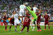 Islam Slimani of Algeria scores his team's first goal on a header past Igor Akinfeev of Russia during the 2014 FIFA World Cup Brazil Group H match...