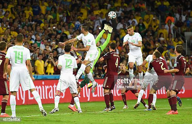 Islam Slimani of Algeria scores his team's first goal past goalkeeper Igor Akinfeev of Russia during the 2014 FIFA World Cup Brazil Group H match...