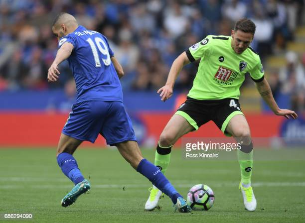 Islam Slimani of Leicester City and Dan Gosling of AFC Bournemouth battle for possession during the Premier League match between Leicester City and...
