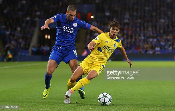 Islam Slimani of Leicester City and Oliver Torres of FC Porto during the UEFA Champions League match between Leicester City FC and FC Porto at The...