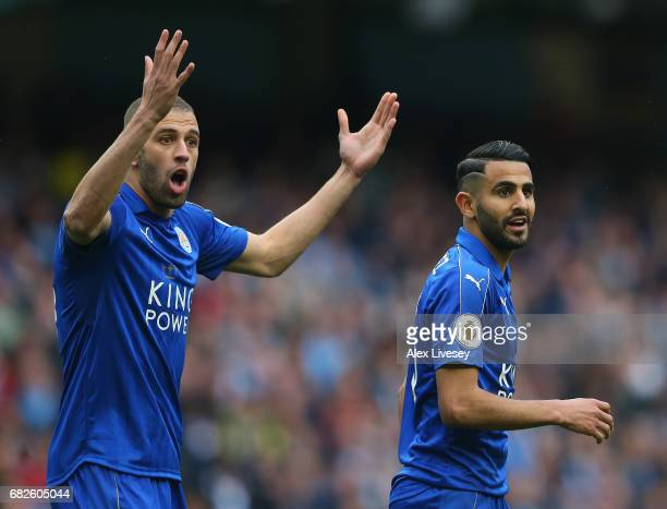 Islam Slimani of Leicester City and Riyad Mahrez of Leicester City reacts to referee Bobby Madley disallowing the penalty goal during the Premier...