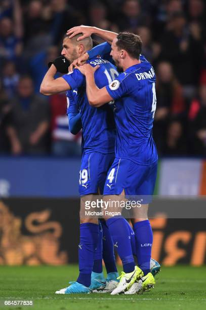 Islam Slimani of Leicester City celebrates scoring his sides first goal with Danny Drinkwater of Leicester City during the Premier League match...