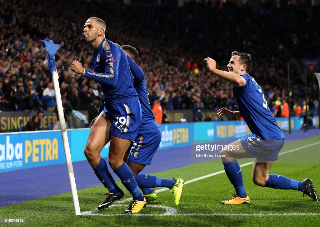 Islam Slimani of Leicester City celebrates scoring his sides second goal with teammates during the Carabao Cup Third Round match between Leicester City and Liverpool at The King Power Stadium on September 19, 2017 in Leicester, England.