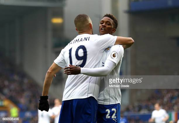 Islam Slimani of Leicester City celebrates scoring his team's opening goal with Demarai Gray during the Premier League match between Everton and...
