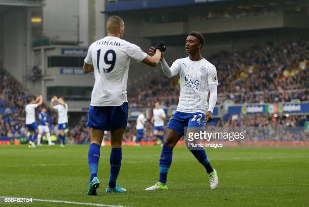Islam Slimani of Leicester City celebrates with Demarai Gray of Leicester City after scoring to make it 11 during the Premier League match between...