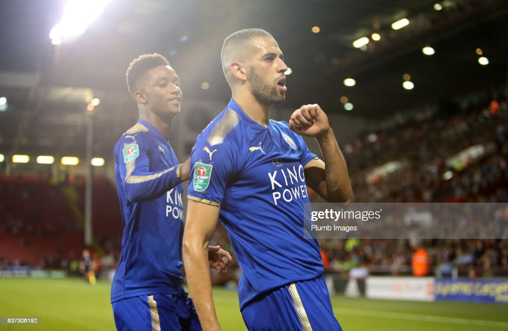 Islam Slimani of Leicester City celebrates with Demarai Gray of Leicester City after scoring to make it 0-2 during the Carabao Cup Second Round tie between Sheffield United and Leicester City at Bramall Lane on August 22nd, 2017 in Sheffield, United Kingdom