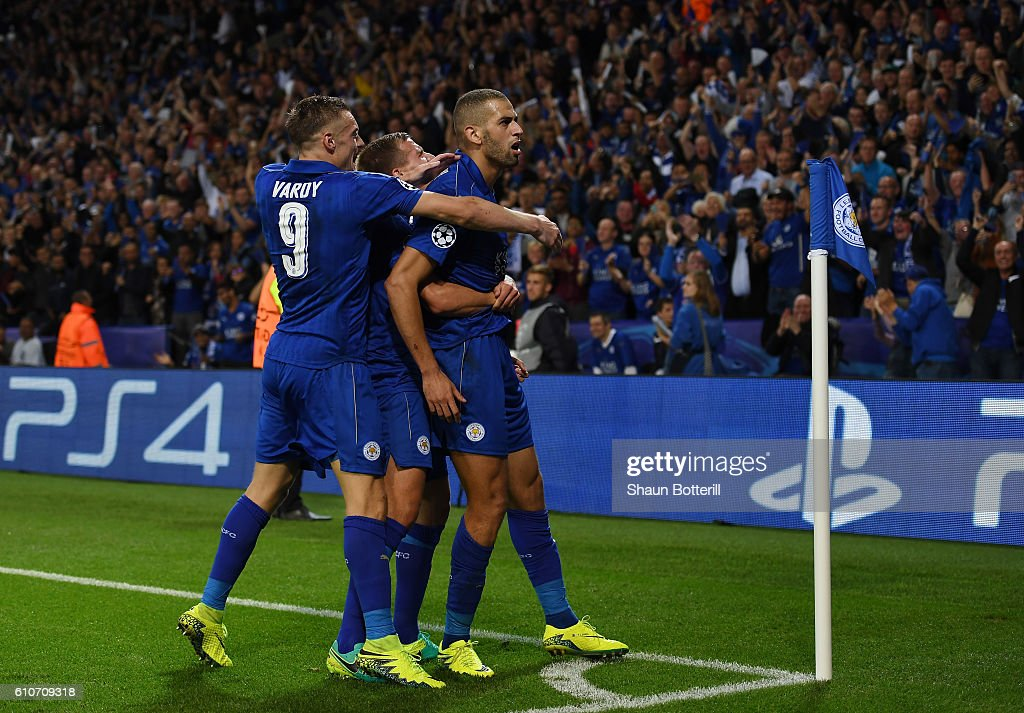 Islam Slimani of Leicester City (R) celebrates with team mates as he scores their first goal during the UEFA Champions League Group G match between Leicester City FC and FC Porto at The King Power Stadium on September 27, 2016 in Leicester, England.