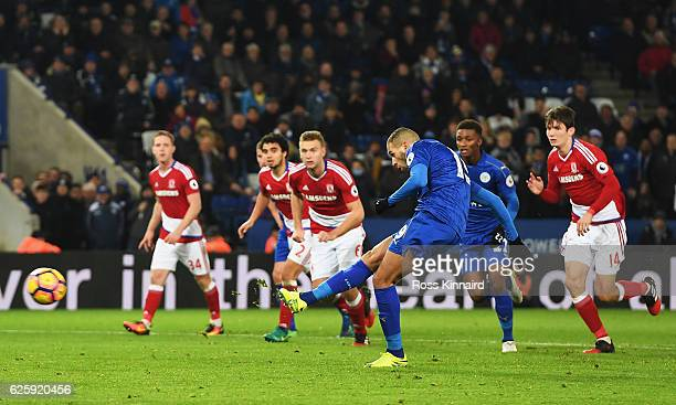 Islam Slimani of Leicester City converts the penalty to score his team's second goal during the Premier League match between Leicester City and...