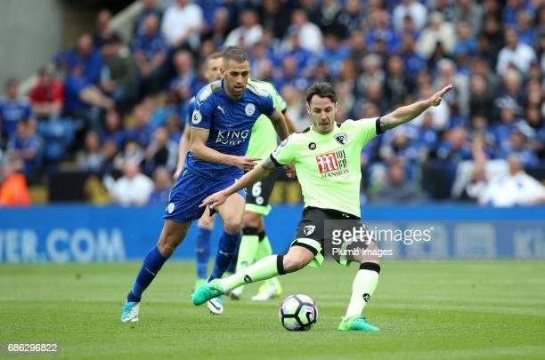 Islam Slimani of Leicester City in action with Adam Smith of Bournemouth during the Premier League match between Leicester City and Bournemouth at...