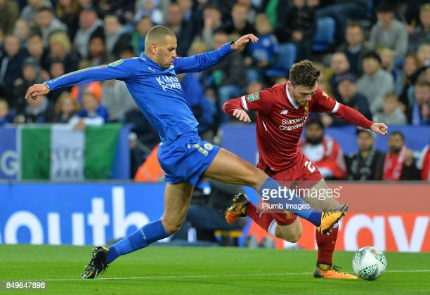 Islam Slimani of Leicester City in action with Andrew Robertson of Liverpool during the Carabao Cup third round match between Leicester City and...