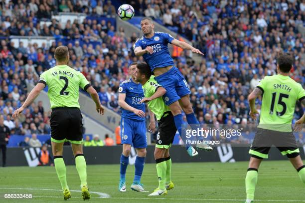 Islam Slimani of Leicester City in action with Andrew Surman of Bournemouth during the Premier League match between Leicester City and Bournemouth at...