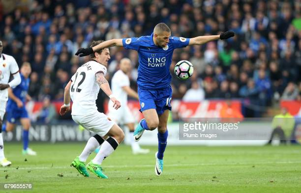 Islam Slimani of Leicester City in action with Daryl Janmaat of Watford during of the Premier League match between Leicester City and Watford at King...