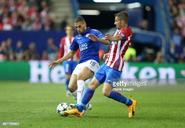 Islam Slimani of Leicester City in action with Gabi of Atletico de Madrid during the Champions League quarter final first leg between Club Atletico...