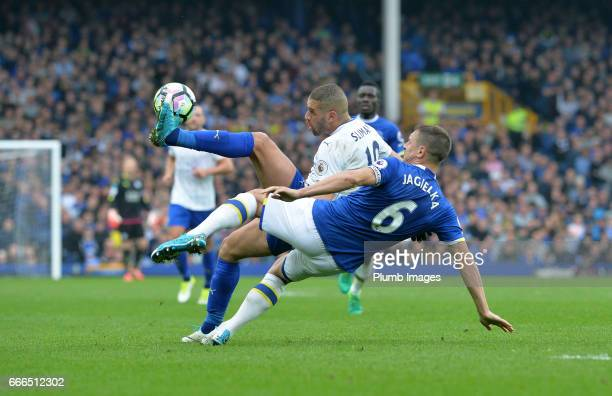 Islam Slimani of Leicester City in action with Phil Jagielka of Everton during the Premier League match between Everton and Leicester City at...