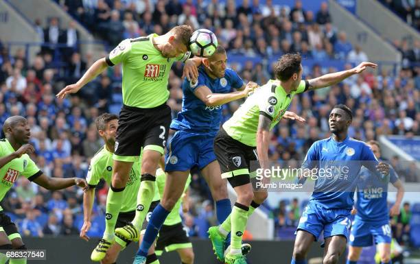 Islam Slimani of Leicester City in action with Simon Francis of Bournemouth during the Premier League match between Leicester City and Bournemouth at...