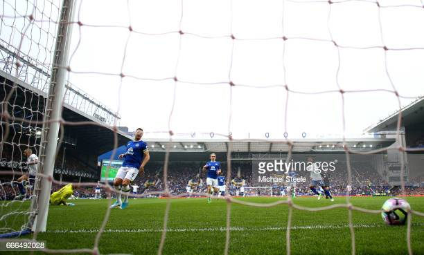 Islam Slimani of Leicester City scores his team's opening goal during the Premier League match between Everton and Leicester City at Goodison Park on...