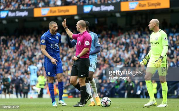 Islam Slimani of Leicester City shows his frustration as referee Robert Madley rules out Riyad Mahrez of Leicester City's penalty during the Premier...