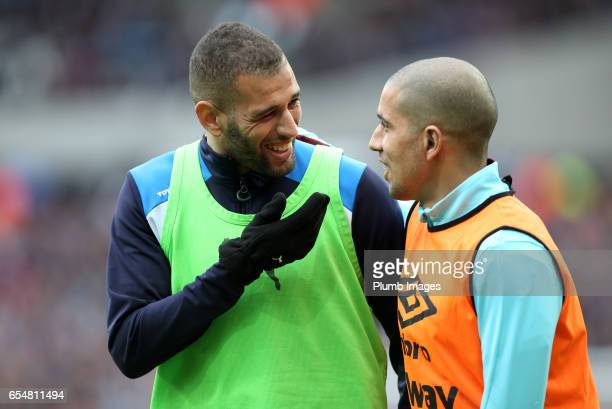 Islam Slimani of Leicester City with Sofiane Feghouli of West Ham during the Premier League match between West Ham and Leicester City at London...