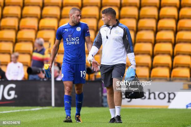 Islam Slimani of leicester goes off injured during the preseason friendly match between Wolverhampton Wanderers and Leicester City at Molineux on...