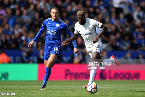 Islam Slimani of Leicestr City puts pressure on Tiemoue Bakayoko of Chelsea during the Premier League match between Leicester City and Chelsea at The...