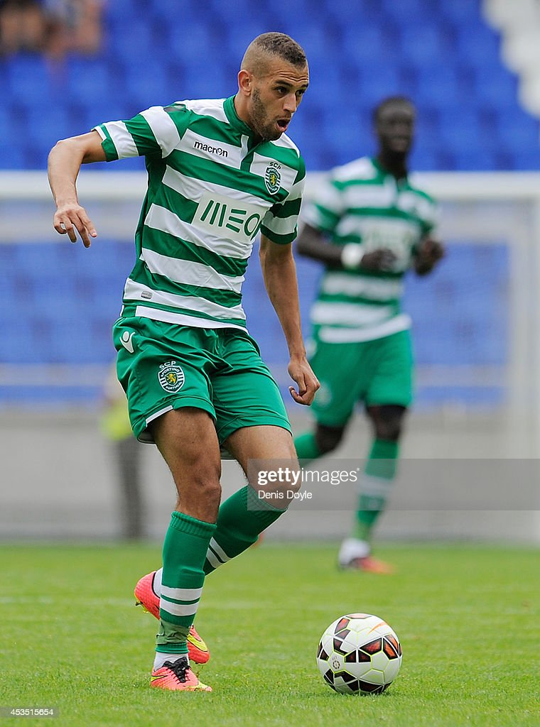 <a gi-track='captionPersonalityLinkClicked' href=/galleries/search?phrase=Islam+Slimani&family=editorial&specificpeople=9704639 ng-click='$event.stopPropagation()'>Islam Slimani</a> of Sporting Clube de Portugal in action during the Teresa Herrera Trophy match between Sporting Clube de Portugal and Club Nacional de Football at estadio Municipal de Riazor on August 10, 2014 in A Coruna, Spain.