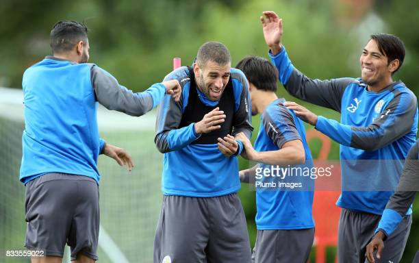 Islam Slimani shares a joke with Leo Ulloa during the Leicester City training session at Belvoir Drive Training Complex on August 17 2017 in...