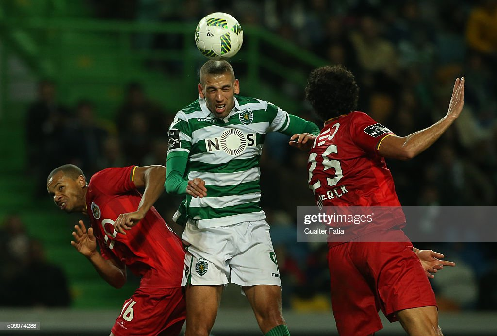 Islam Slimani (C) with Rio Ave FC's defender Edimar (L) and Rio Ave FC's defender Roderick Miranda (R) in action during the Primeira Liga match between Sporting CP and Rio Ave FC at Estadio Jose Alvalade on February 8, 2016 in Lisbon, Portugal.