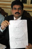 Head of Pakistani minority communities alliance Shahbaz Bhatti shows a piece of paper listing threats during a press conference in Islamabad 16 May...