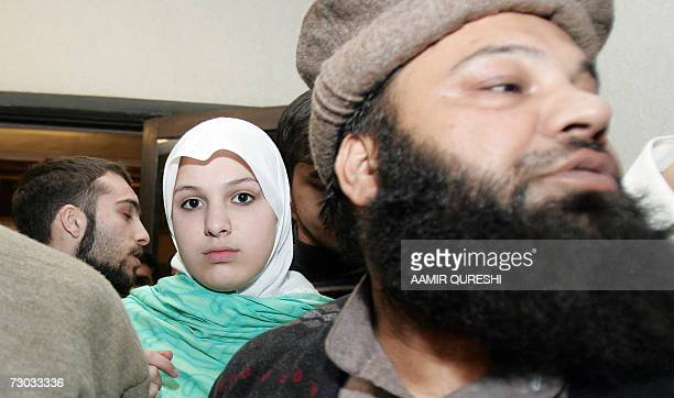 Molly Campbell also known by her Muslim name Misbah Iram Ahmad Rana leaves the court with her father Sajjad Ahmed Rana after the Supreme Court...