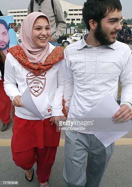 Molly Campbell who is also known by her Muslim name Misbah Iram Ahmad Rana and her brother Adam Ahmed Rana cross a road after a demonstration by...