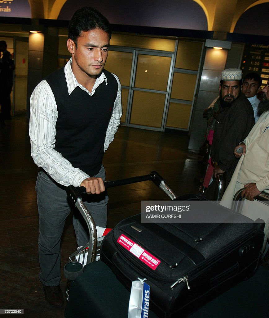 Pakistani cricketer Yasir Arafat arrives at Islamabad airport, 28 March 2007, after a two-day stopover in London. Pakistan's cricket chief promised legislators that players will get legal aid if they are summoned to Jamaica for questioning over the murder of Coach Bob Woolmer. Pakistan Cricket Board chairman Naseem Ashraf was also asked when he appeared before the senate committee for sports about the team's poor performance at the World Cup, where Pakistan were dumped out by Ireland. AFP PHOTO/Aamir QURESHI