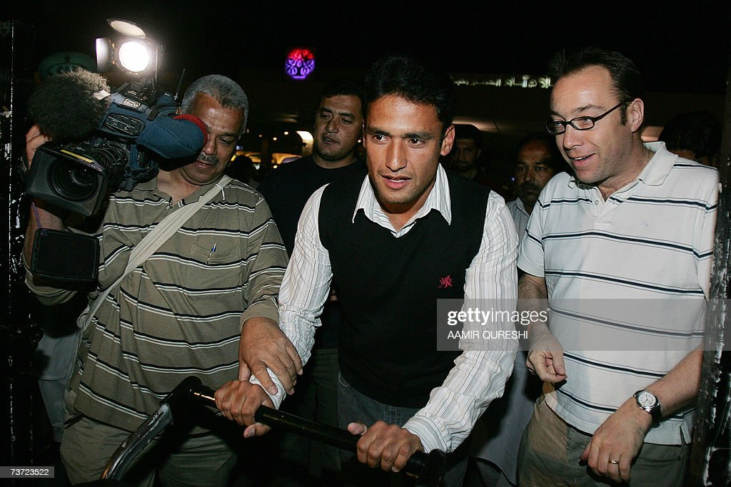 Pakistani cricketer Yasir Arafat (C) avoids the media upon his arrival to Islamabad airport, 28 March 2007, after a two-day stopover in London. Pakistan's cricket chief promised legislators that players will get legal aid if they are summoned to Jamaica for questioning over the murder of Coach Bob Woolmer. Pakistan Cricket Board chairman Naseem Ashraf was also asked when he appeared before the senate committee for sports about the team's poor performance at the World Cup, where Pakistan were dumped out by Ireland. AFP PHOTO/Aamir QURESHI