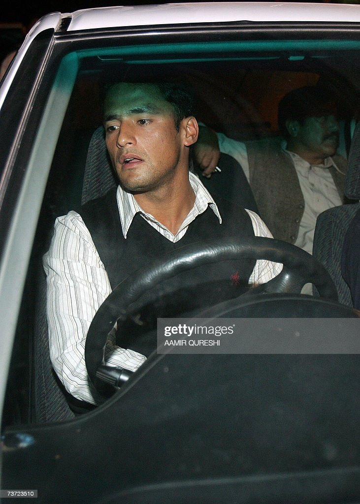 Pakistani cricketer Yasir Arafat sits in a car as he drives upon his arrival to Islamabad airport, 28 March 2007, after a two-day stopover in London. Pakistan's cricket chief promised legislators that players will get legal aid if they are summoned to Jamaica for questioning over the murder of Coach Bob Woolmer. Pakistan Cricket Board chairman Naseem Ashraf was also asked when he appeared before the senate committee for sports about the team's poor performance at the World Cup, where Pakistan were dumped out by Ireland. AFP PHOTO/Aamir QURESHI
