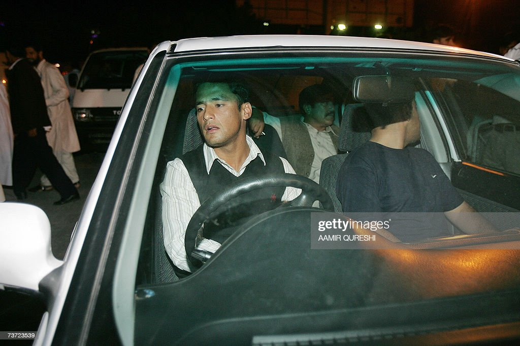 Pakistani cricketer Yasir Arafat (L) sits in a car upon his arrival to Islamabad airport, 28 March 2007, after a two-day stopover in London. Pakistan's cricket chief promised legislators that players will get legal aid if they are summoned to Jamaica for questioning over the murder of Coach Bob Woolmer. Pakistan Cricket Board chairman Naseem Ashraf was also asked when he appeared before the senate committee for sports about the team's poor performance at the World Cup, where Pakistan were dumped out by Ireland. AFP PHOTO/Aamir QURESHI
