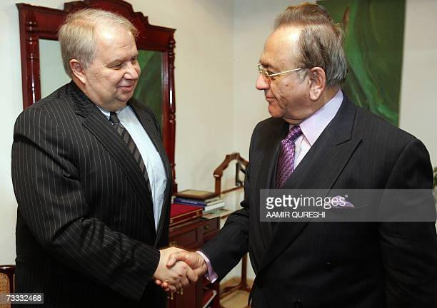 Pakistani Foreign Minister Khurshid Kasuri greets Russian Deputy Foreign Minister Sergey Kislyak prior to their meeting in Islamabad 15 February 2007...
