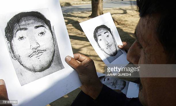 Pakistani men look at the sketches of an alleged suicide bomber in Islamabad 01 February 2007 which were released by police 31 January Pakistani...