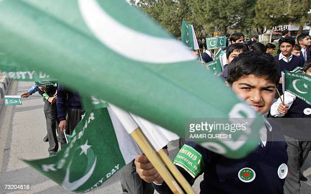 Pakistani students hold National flags as they march and chant slogans against India's administration of Indian Kashmir as they observe 'Kashmir...