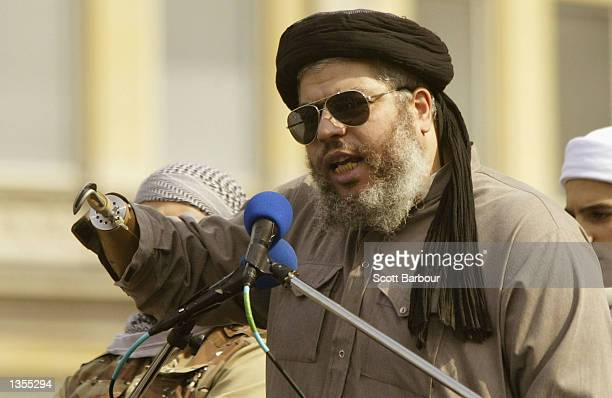 Islamic cleric Abu Hamza speaks during the Rally for Islam August 252002 at Trafalgar Square in London United Kingdom The rally was organized by the...