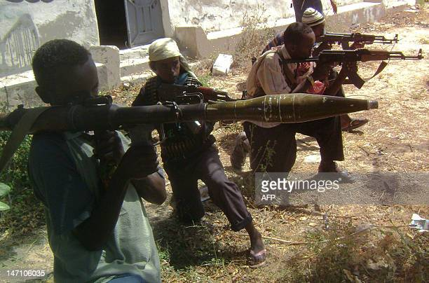Islamic fighters hold their guns during a training exercise in Mogadishu in Somalia on January 12 2009 Ethiopian forces pulled out on January 13 from...