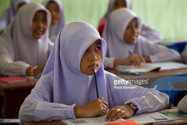 Islamic girls attend classes at the Darunsat Wittaya school on August 16 2011 in Saiburi southern Thailand Over 4000 students attend classes at one...