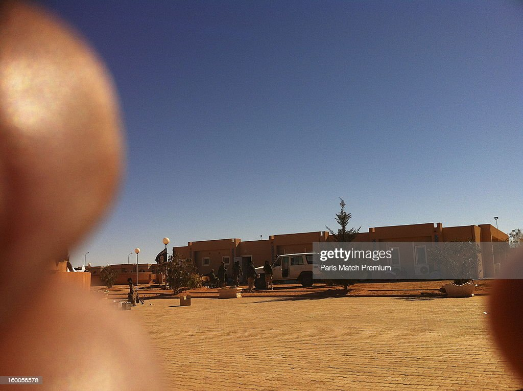 Islamic jihadists who attacked the Algerian gas site of Tinguentourin are seen in a photograph taken by an unnamed hostage with his mobile phone on January 16, 2013 in Amenas, Algeria. Dozens of civilians and militants were killed during the four day siege undertaken by a group led by jihadist Mokhtar Belmokhtar.