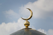 Islamic moon - the sign on the mosque n front of sunny day sky