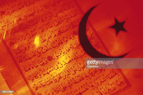 Islamic symbol over Koran